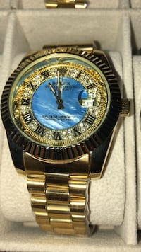 round gold-colored analog watch with link bracelet Brampton, L6T 4A2