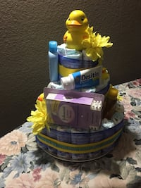 Diaper cake with baby essentials $60 only with flower and ribbon $45 Los Angeles, 90042