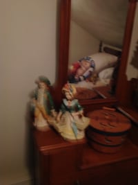 Two green, beige, and yellow figurines wearing headdress  East Providence, 02914
