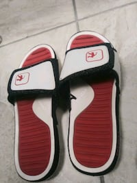 pair of white-and-red Nike slide sandals Fort Myers, 33903