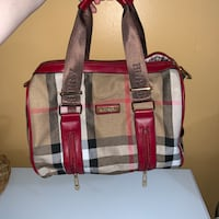 Burberry leather handbag with cosmetics accessories