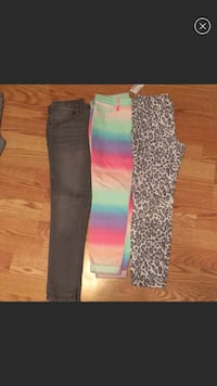 Girls size 8 jeggings. Grey and animal print pants used once; rainbow colored still has tags. Selling all 3 pieces  Weslaco, 78596