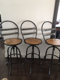 three wood and metal bar stools Mississauga