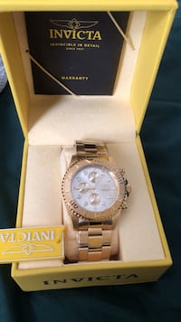 round silver-colored Rolex chronograph watch with link bracelet Bay Shore, 11706