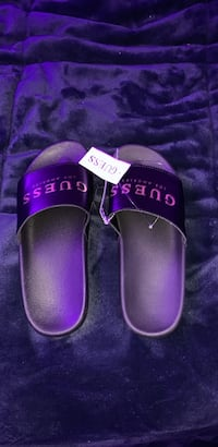 Pair of black guess slides original price $72 size 8.5/9 woman's  North Vancouver, V7K 1L8