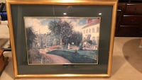 Gold framed painting of house/trees