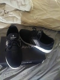 pair of black Rocawear running shoes with box