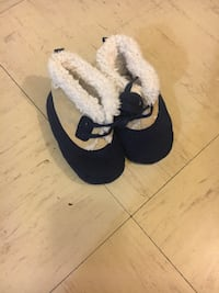 Pair of black-and-white slide sandals 551 km