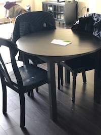 round black wooden table with two chairs Bethesda, 20814
