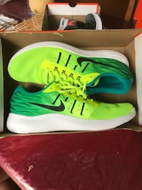 Pair of green-and-white nike running shoes Vaughan, L4J 8W4