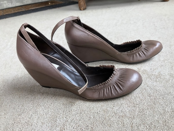 pair of gray leather peep-toe heeled shoes 0