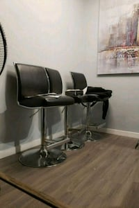 three black leather padded bar stools Vancouver, V5T 1H9