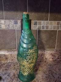 green and brown translucent glass vase