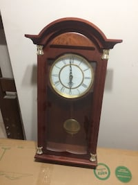 Brown pendulum clock Calgary, T2J 6L8