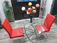 Dinning table and 2 Red faux leather chairs Pickering, L1W 3A9
