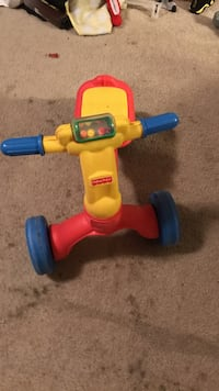 yellow red and blue fisher price trike