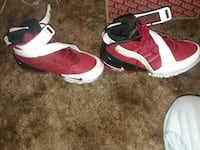 pair of white-and-red Nike basketball shoes Anderson, 96007