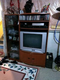 brown wooden TV hutch and TV Brampton, L7A 3P3