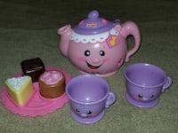 pink and purple Fisher-Price tea toy set