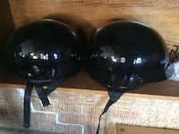 Two black nut sheel helmets Moose Jaw