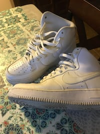 pair of white Nike high top Air Force 1