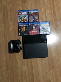 black Sony PS4 Original with controller and several assorted-title game cases New York, 11207