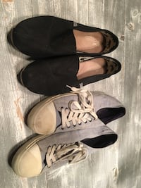 pair of black Toms slip-on shoes with pair of gray low-top sneakers