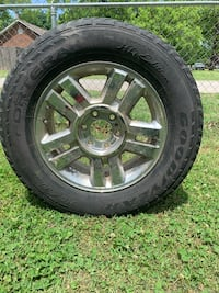 Ford F150 stock rim with tire $90 OBO