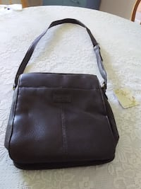 New RELIC dark brown crossover purse with outside pocket for cell phone and many inside sections to keep organized
