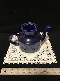 blue and white ceramic teapot 57 km