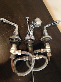 silver-steel hot and cold faucet