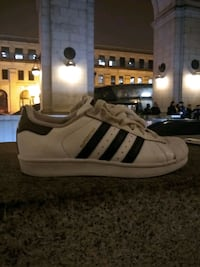 pair of white-and-black Adidas Superstar Washington, 20002