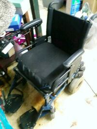 Motorized wheel chair.  Needs a charger.   Jeannette, 15644