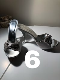 Pair of silver open toe ankle strap heels size 6