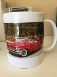 brown, red, and white red car print ceramic mug