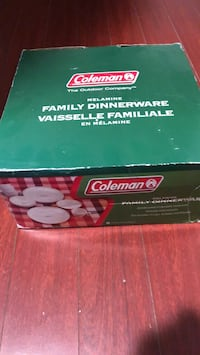 NEW. Never used Coleman camping dinnerware set.