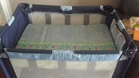gray and green floral playpen Ontario, L4L 3W5