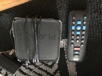 black wd PLAY TV box and remote