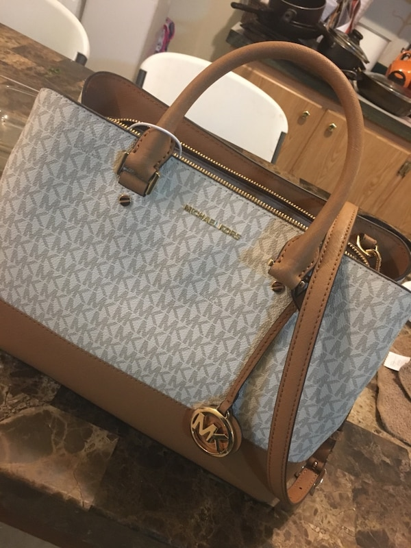 f19ab1e4ff0a Used gray and brown Michael Kors leather tote bag for sale in Salt ...