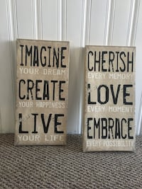 two imagine create live and cherish love embrace signages