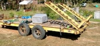 red and brown utility trailer 392 mi