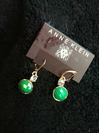 pair of gold-and-green Anne Klein dangle earrings