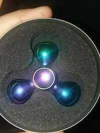 blue and green hand spinner Omega, 31775