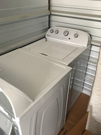 Whirlpool electric washer/dryer combo. Includes all hoses and plugs.