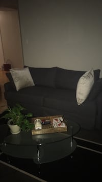 black wooden frame with white padded sofa Montréal, H3G 2K1
