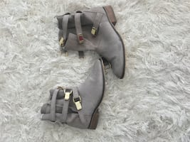 Grey suede boots with gold buckle detail