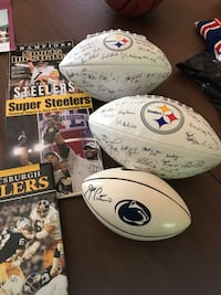 Three footballs signed by Steelers. More Steeler paraphernalia, too. Purcellville, 20132