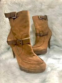 pair of brown suede boots