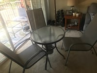 round gray table with three armchairs patio set 39 km