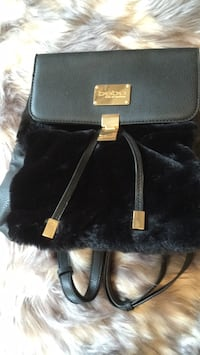 Brand new Bebe faux fur backpack. Adorable !